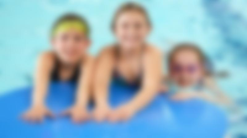 Girls in swimming pool at Embassy Outdoor Swimming Pool in Skegness
