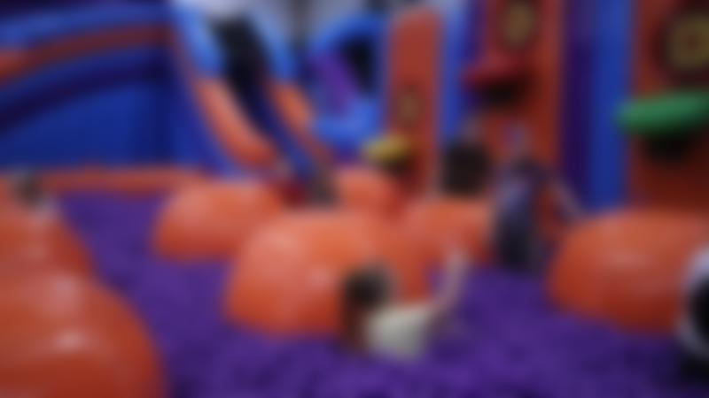 Kids playing in a ball pit at Inflata Nation Manchester