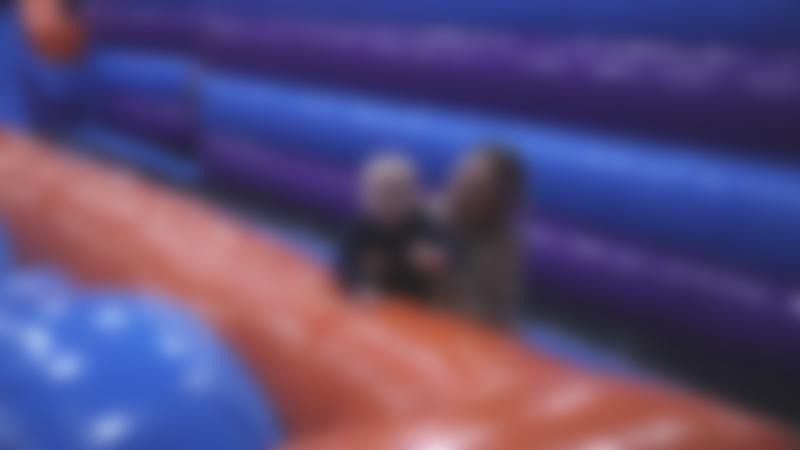 Mum and baby smiling at Inflata Nation Manchester
