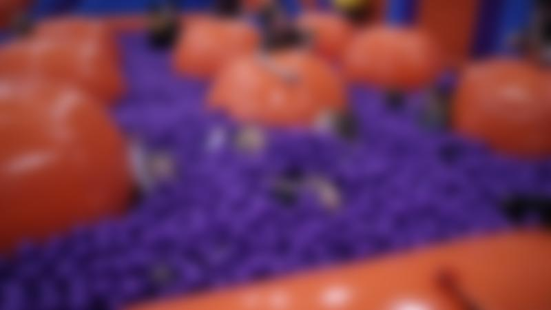Some people in the ball pit at Inflata Nation in Manchester