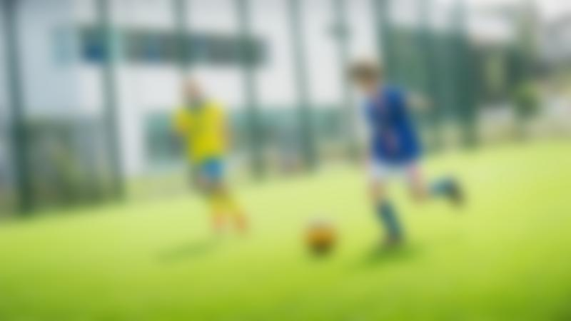 Boy playing football at Cockermouth Sports Centre
