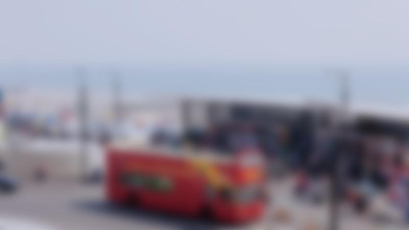 City Sightseeing Bournemouth Hop on Hop off Tour bus at the beach