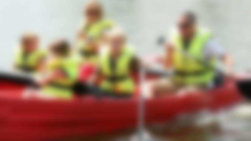 Family canoeing at Dinton Activity Centre in Hurst