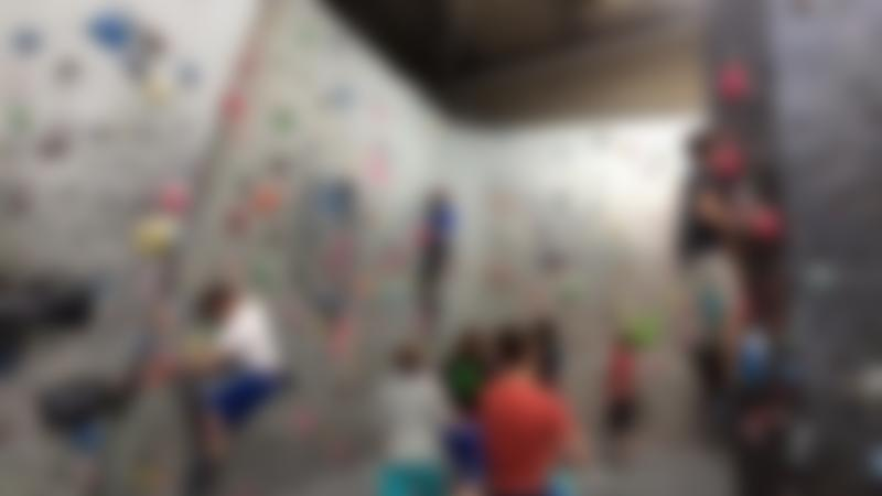 People bouldering at Highball Climbing Centre in Norwich