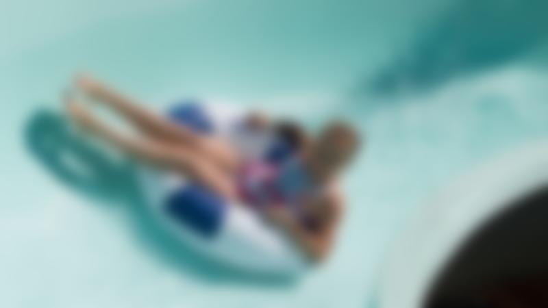 Girl on flume at Splashdown Quaywest Waterpark in Paignton