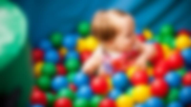 Baby girl in ball pit at Wacky Warehouse - Mottram Woods in Longdendale