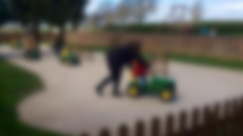 Kids on toy tractor at Wheelock Hall Petting Farm in Sandbach