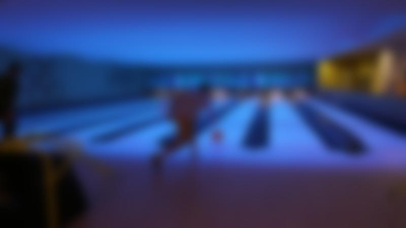 Man bowling at Eldon Leisure Centre in Newcastle upon Tyne