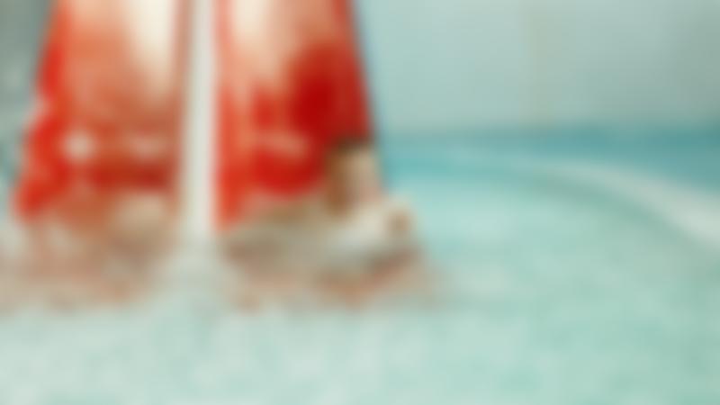 Boy on water slide at Wet N Wild in North Shields