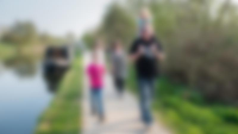 Family walking at Lee Valley Regional Park in Broxbourne