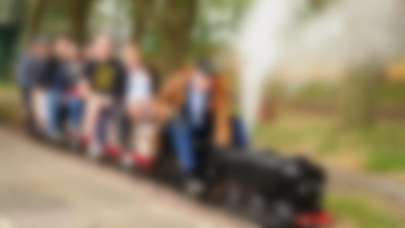 People on miniature train at Summerfields Miniature Railways in Bedford