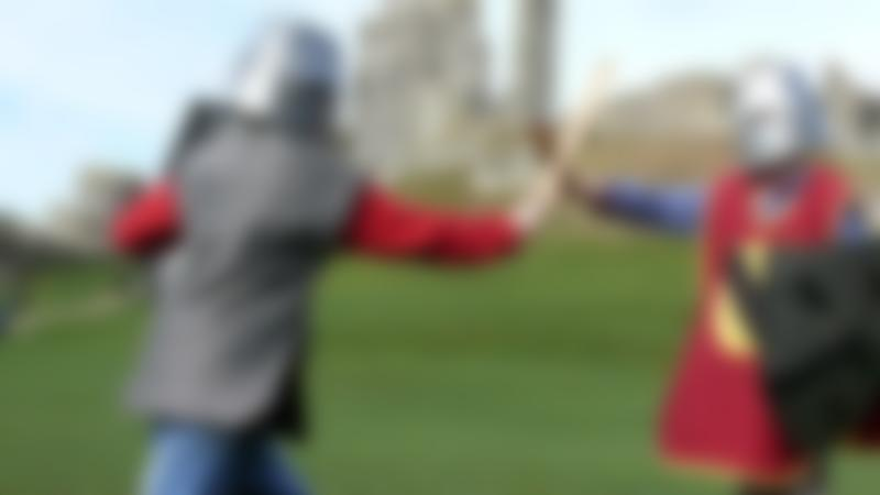 Kids fighting as knights at Corfe Castle in Wareham