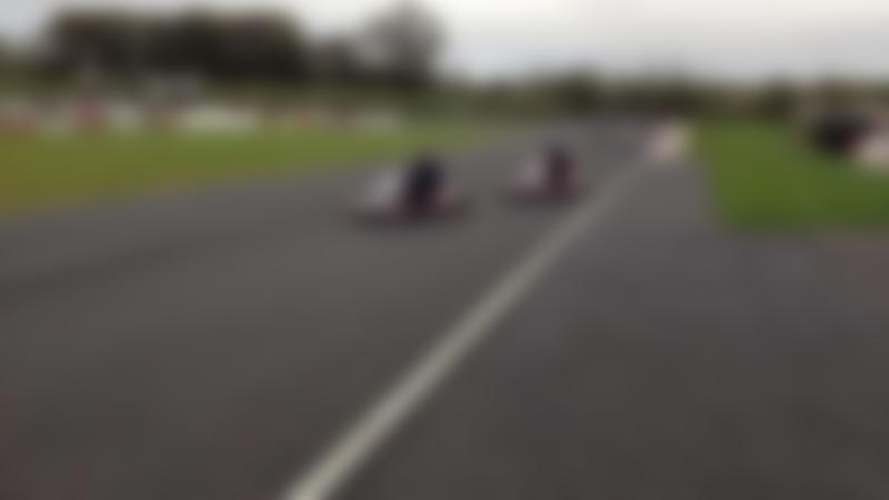 Kids racing on go karts at Nutts Corner Circuit in Belfast