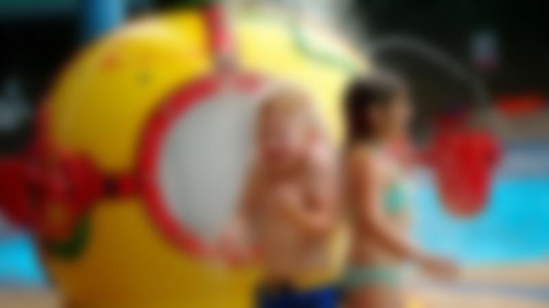 Kids under sprinklers in swimming pool at Swan Centre For Leisure in Berwick-upon-Tweed