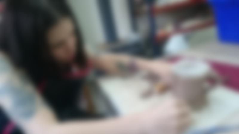 Woman forming mug at Eastcott Studios in Swindon