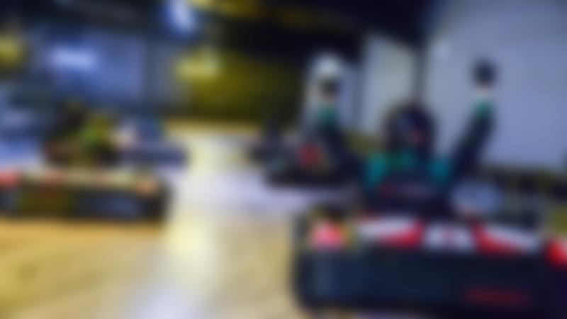 People go kart racing at TeamSport Indoor Karting Reading