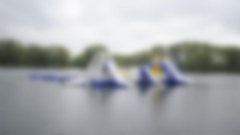 Inflatable course on lake at Ride Leisure Events in Wyboston