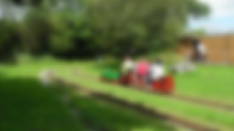 Family on train at Bridgend Miniature Railway