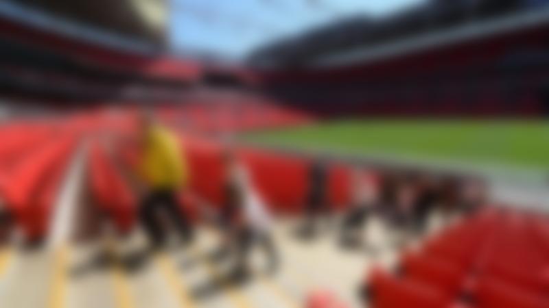 People walking up stadium stairs at Wembley Stadium