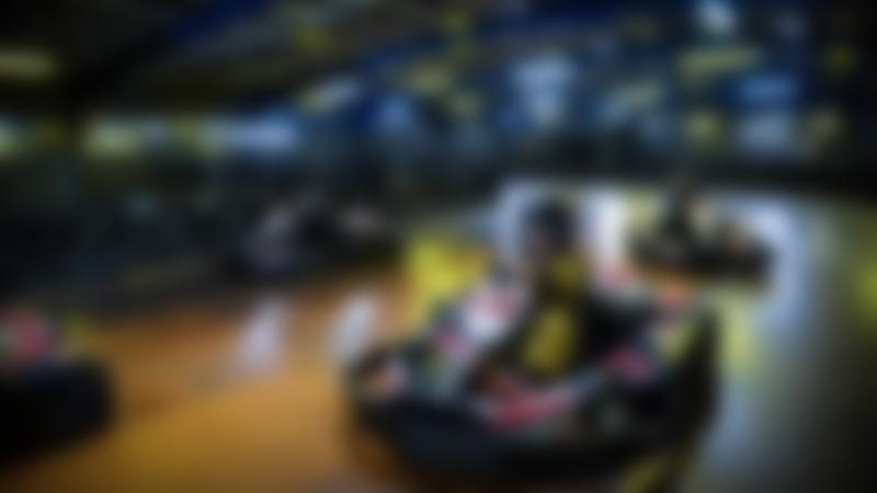 Some people karting at TeamSport Indoor Karting Manchester Trafford Park