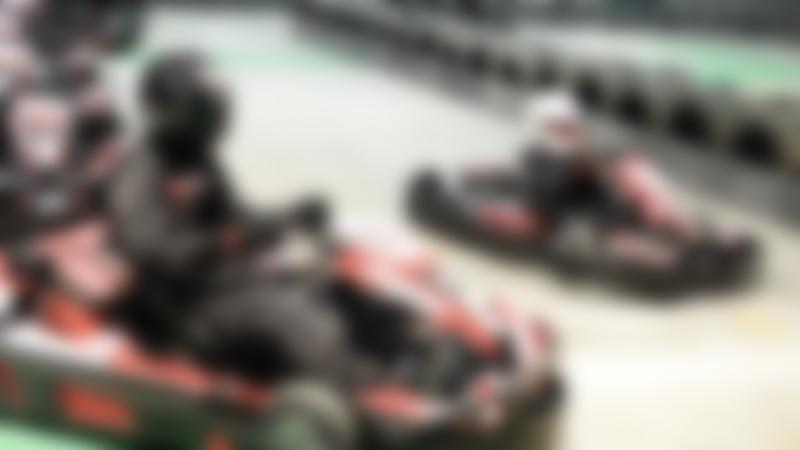 People on the track at TeamSport Indoor Karting Manchester Trafford Park