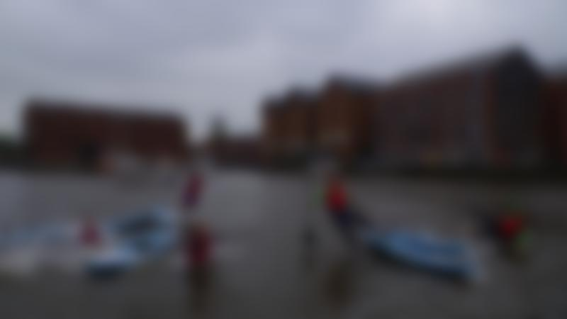 People with paddle boards at SUP Gloucester