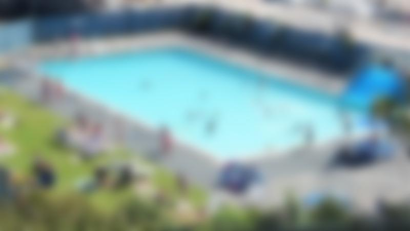 Families in outdoor swimming pool at Hayle Swimming Pool