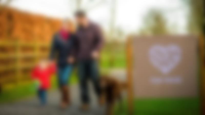 Family and dog at Donkey Sanctuary in Abbey Hey