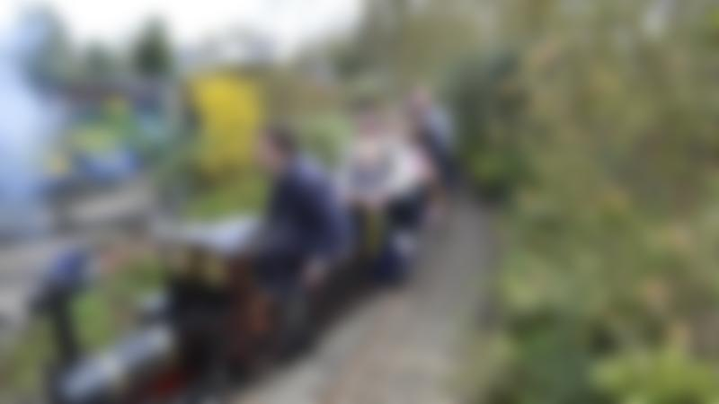 Family on miniature train at Cutteslowe Park and Miniature Railway in Oxford