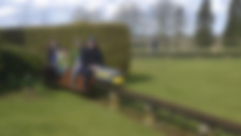 Family on train at Cutteslowe Park and Miniature Railway in Oxford