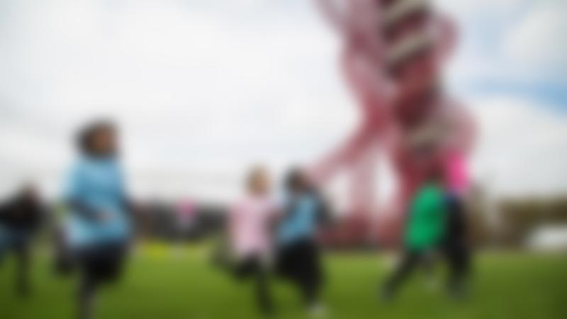 Kids running at Queen Elizabeth Olympic Park in London