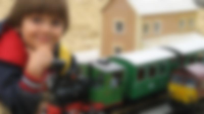 Boy playing with miniature train at Railworld in Peterborough