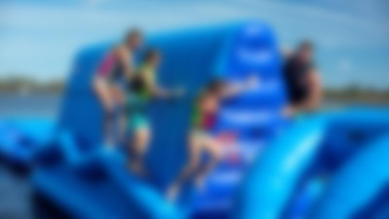 Family on inflatable course at Southlake Aqua Park in St Neots