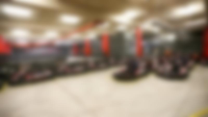 People on go karts at TeamSport Indoor Karting Manchester