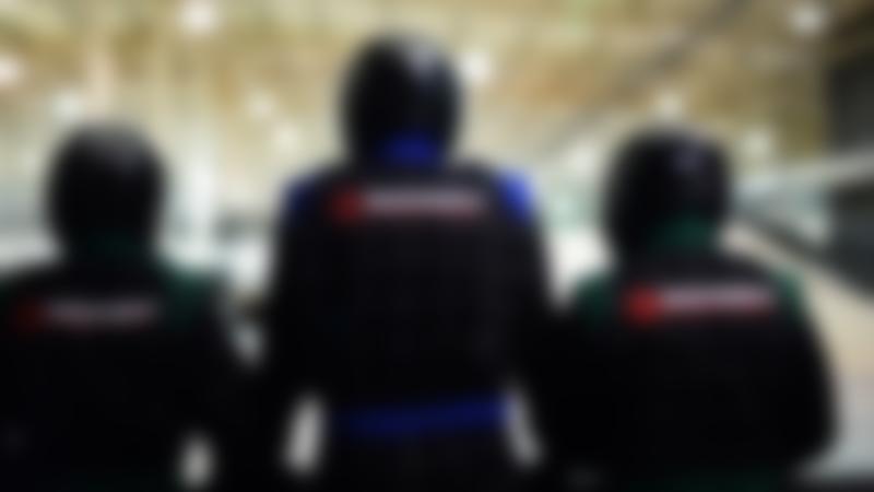Peoples backs showing the TeamSport logo at TeamSport Indoor Karting in Nottingham