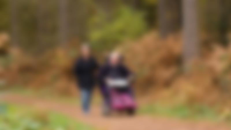 Couple walking at Delamere Forest in Cheshire