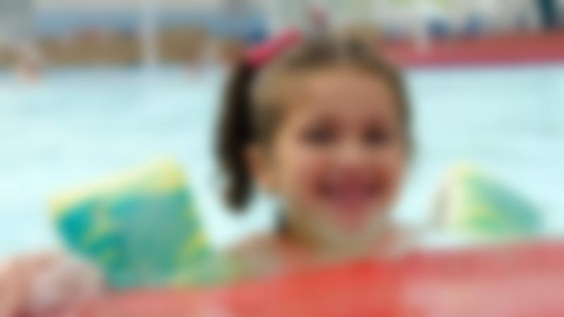 Kids in swimming pool at Sobell Leisure Centre in Highbury