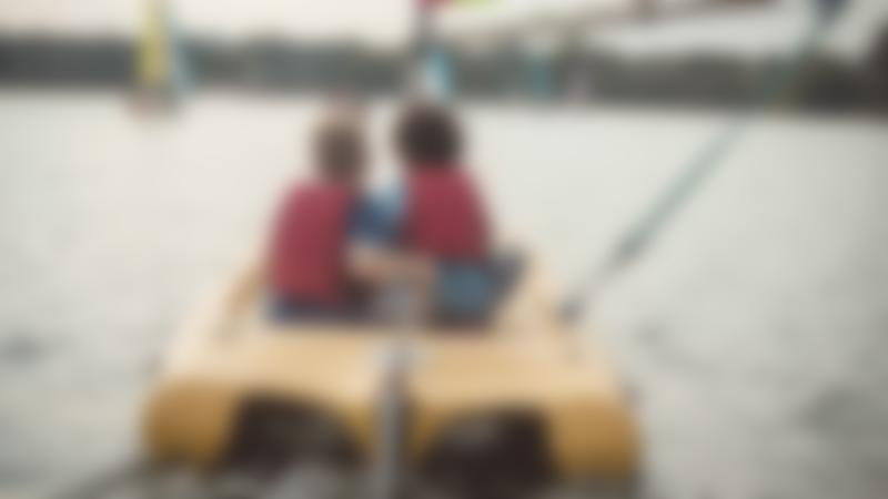 Kids on boat at Willen Lake and Park in Milton Keynes