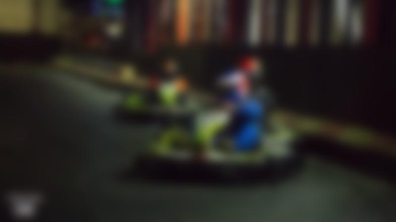 People racing at Swindon Karting Arena