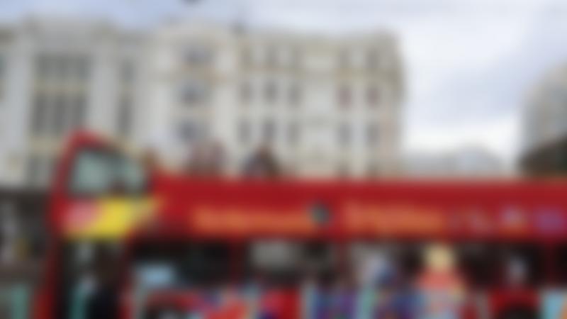Passengers on City Sightseeing Brighton Hop on Hop off Tour bus