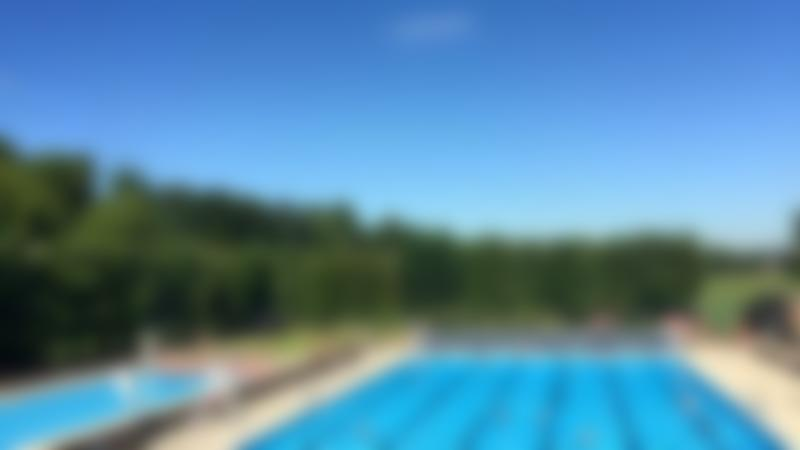 Families in outdoor swimming pool at Wycombe Rye Lido