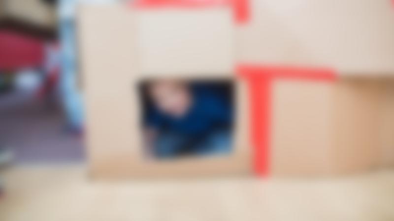 Boy in cardboard at The Yard Stamford