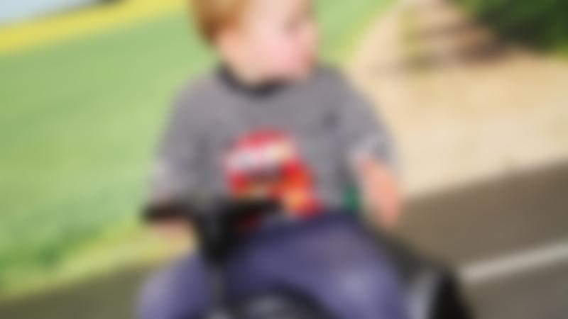 Boy on toy car at Tots Town in Norwich