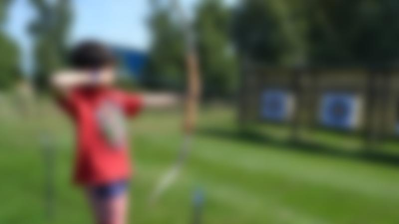 Boy doing archery at Wild Tracks in Newmarket