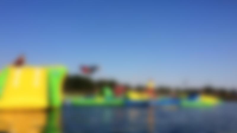 Inflatable course on lake at Box End Park in Kempston