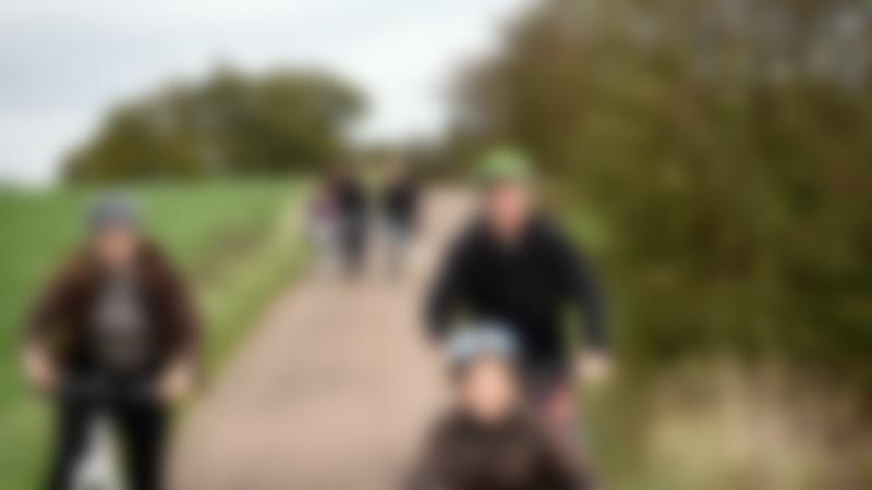 Family cycling at Calke Abbey, Derbyshire