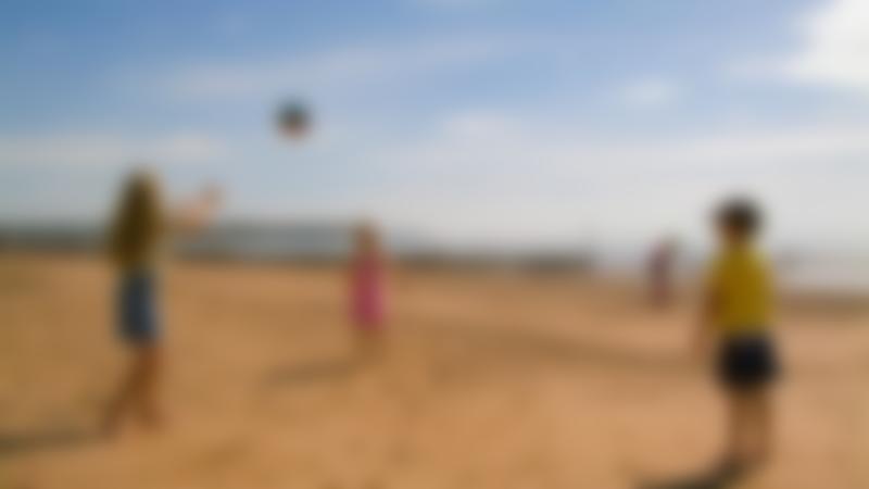 Kids playing catch at Dawlish Warren Beach