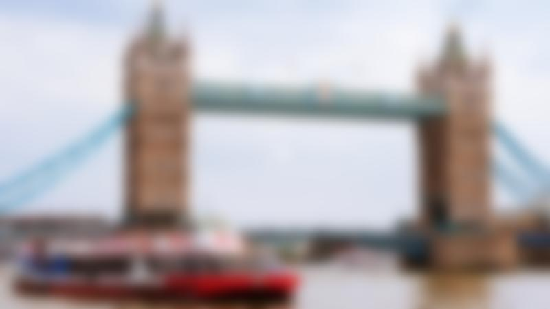 Passengers on City Cruises passing London Bridge in Westminster