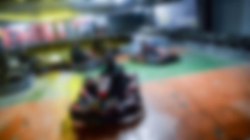 People racing at Scotkart Indoor Kart Racing Clydebank