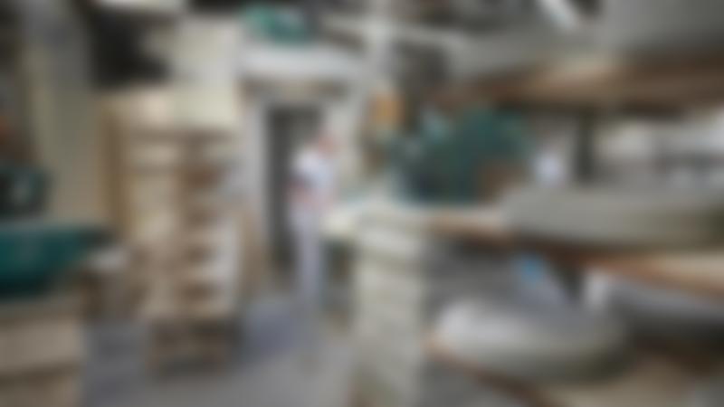 Man making ceramics at Royal Stafford Ceramic Cafe in Burslem